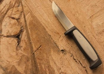 skinning knife on a block of wood