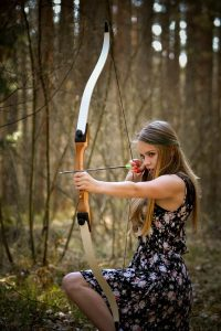 woman pulling a recurve bow