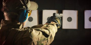 man target shooting with ear protection