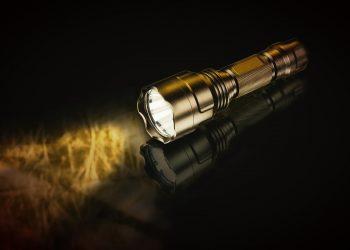 a metallic flashlight on