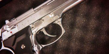 Silver Handgun on Black Foam Closeup