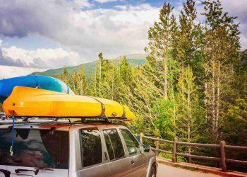 Car loaded with sea kayaks