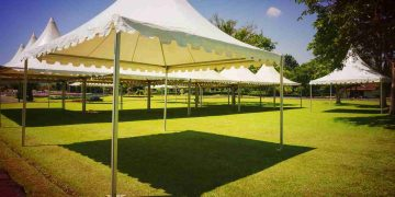 a white tent on a grassy field