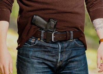 man with a gun inside his belt