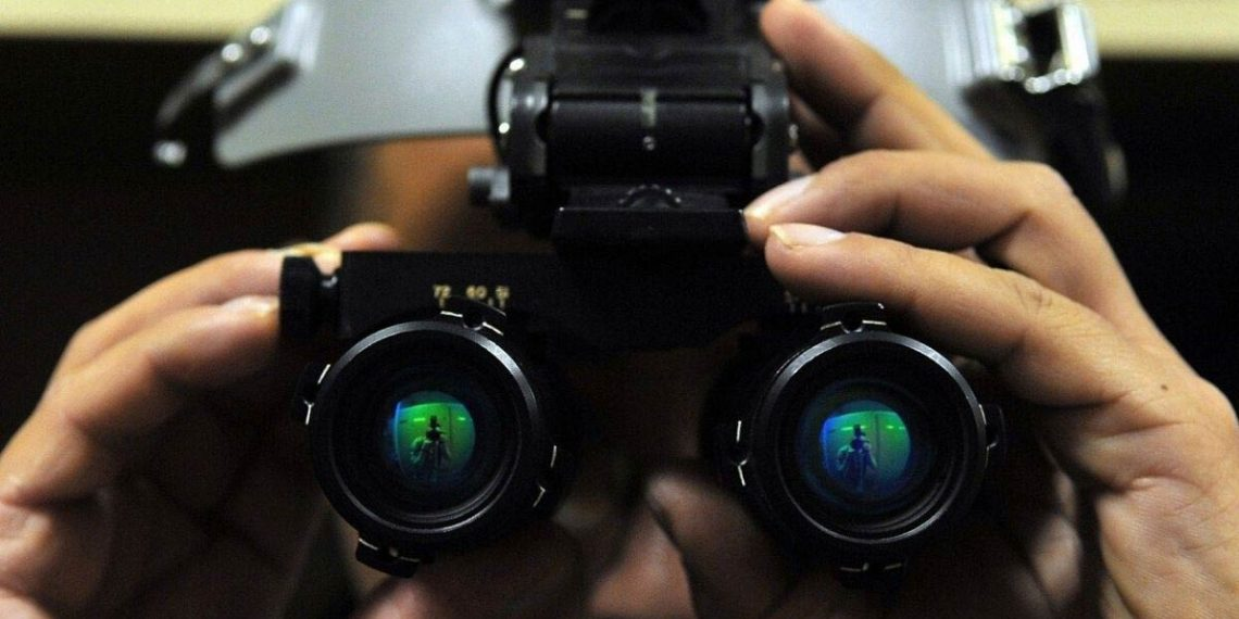 man using night vision goggles