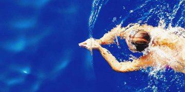 Man swimming through the water