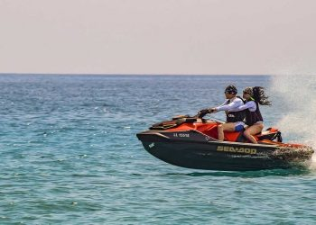 Couple on a jet ski at sea