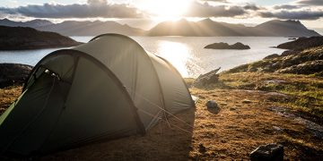 tent on a hill facing the sunset