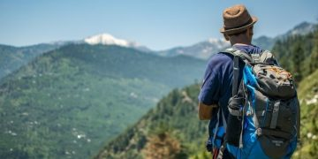 Man hiking with backpack on mountain